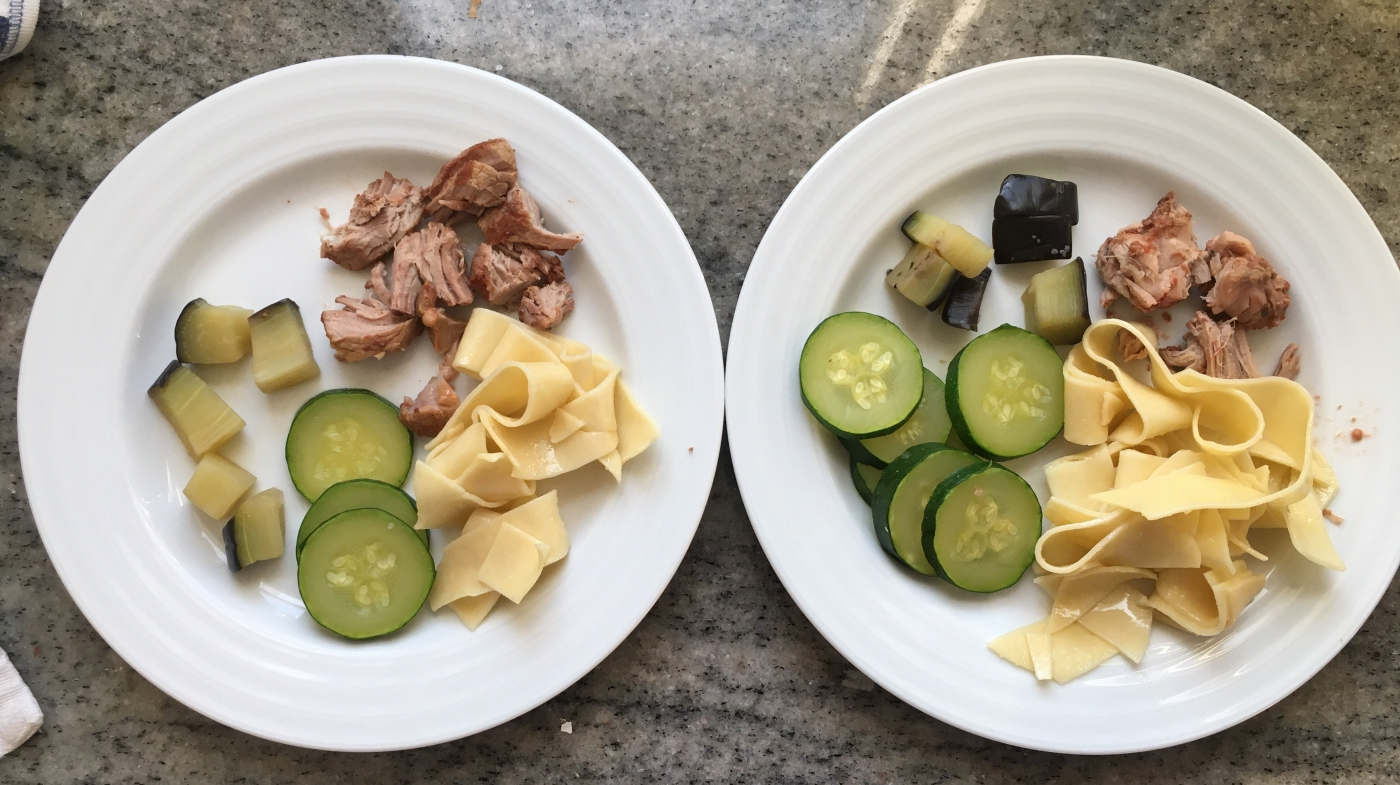 Picture of kids plates with the steamed zucchini and eggplant.