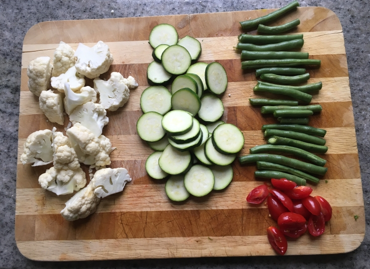 Chopped cauliflower, zucchini, green beans & grape tomatoes picture