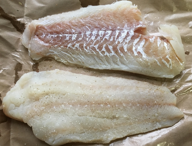 Fish fillets seasoned with salt and pepper