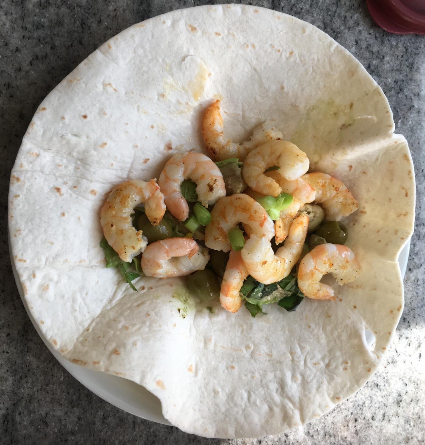 Shrimp, avocado, green garlic, basil burritos.