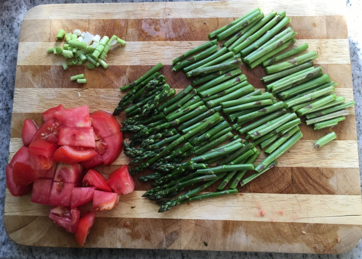 Chopped asparagus spears, tomato & green garlic